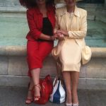 Testimonials Red trouser suit and cream dress suit
